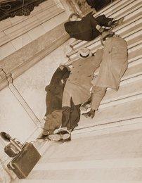 Photographers Nap on Courthouse Steps