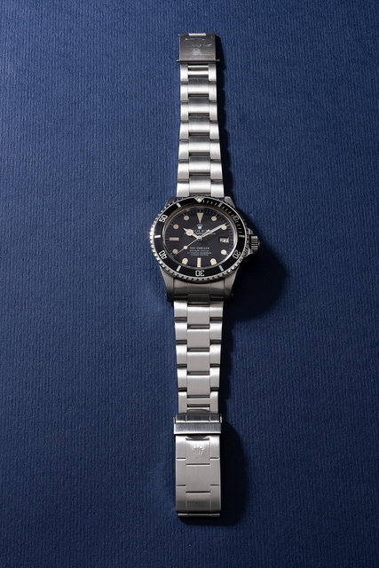 """Rolex, 'An attractive and very rare stainless steel diver's wristwatch with """"rail dial"""", helium escape valve, date, sweep center seconds, bracelet, guarantee, hang tags and box', Circa 1978, Phillips"""