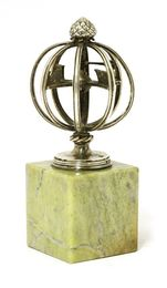 A silver desk weather vane or armillary sphere