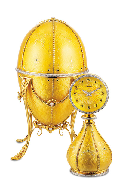 Asprey, 'A very fine and rare yellow gold, enamel, diamond and pearl-set egg-shaped clock with yellow gold stand and presentation box', Circa 1991, Phillips