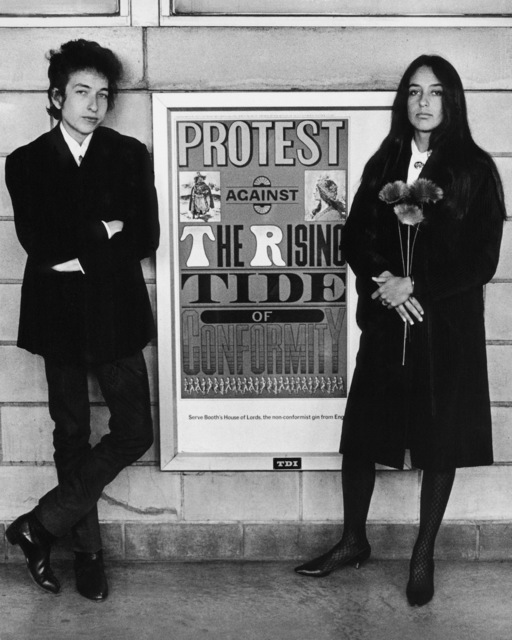 , 'Bob Dylan & Joan Baez with Protest Sign, Newark Airport,' 1964, TASCHEN