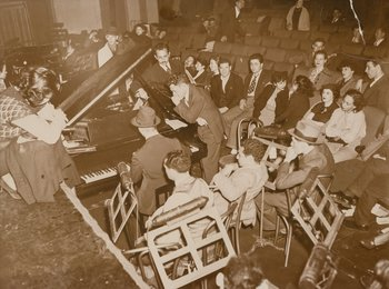 Audience Ends All-Night Sit-In, WPA Cast Strikes Over Layoffs (five photographs)