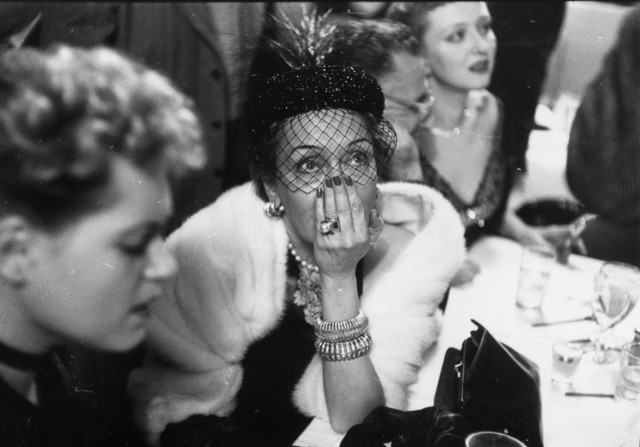 , 'Gloria Swanson awaiting the results of the Academy Award for Best Actress at a cafe on West 52nd Street, New York,' 1951, Staley-Wise Gallery