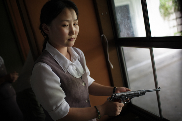, 'A North Korean woman loads a pistol for firing practice in Pyongyang, North Korea,' 2007, Museum of Contemporary Photography (MoCP)