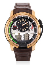 A fine and rare pink gold and titanium semi-skeletonized wristwatch with retrograde fluorescent liquid capillary time indicator, power reserve indicator, international warranty certificate and presentation box