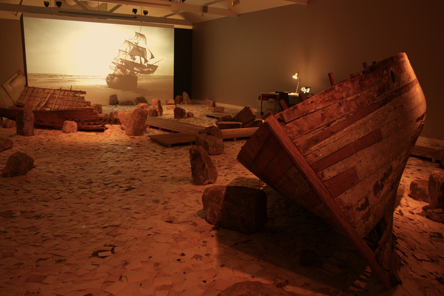 Dinh Q. Lê, 'Erasure', 2011, Installation, Single-channel color video with sound, found photographs, stone, wooden boat fragments, wood walkway, computer, scanner, dedicated website (erasurearchive.com), Mori Art Museum