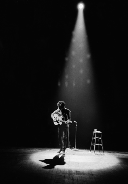 , 'Bob Dylan Performing in Spotlight, Princeton, NJ,' 1964, TASCHEN