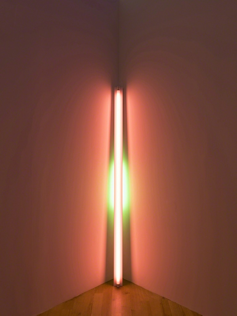 Dan Flavin, untitled, 1969. Pink and green fluorescent light. 8 ft. leaning into a corner with the top of the 20W tube touching the corner. Installation view:Dan Flavin: cornered fluorescent light, Mana Contemporary, Jersey City, 2018. Photo: John Berens. Courtesy of the Estate of Dan Flavin