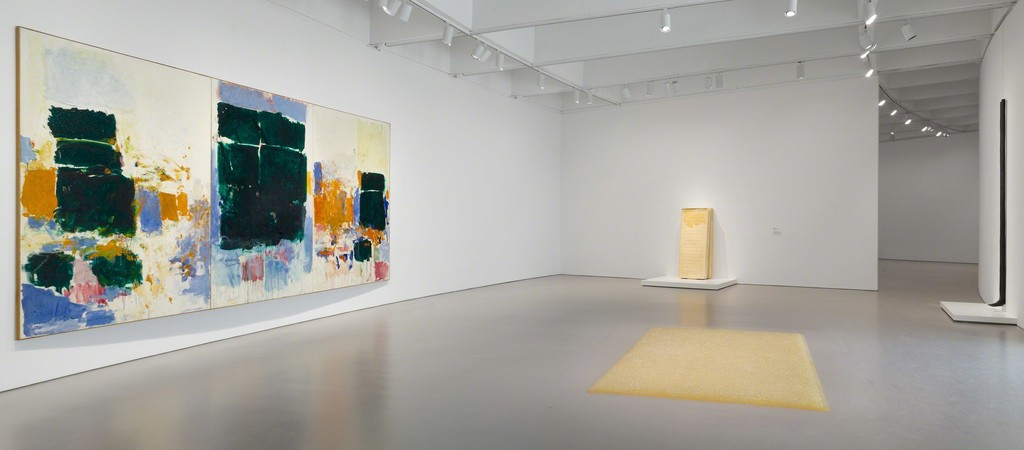 Installation view of Masterworks from the Hirshhorn Collection at the Hirshhorn Museum and Sculpture Garden, 2016. Left to right: Joan Mitchell, Field for Skyes, 1973; Rachel Whiteread, Untitled (Yellow Bed, Two Parts), 1991; Mona Hatoum, Entrails Carpet, 1995; Louise Bourgeois, Legs, 1986, cast 2008.  Photo: Cathy Carver