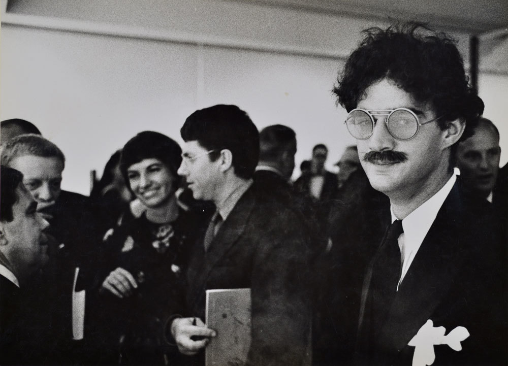 Larry Bell at the Opening Reception (Ed Moses and Robert Irwin in background), Duchamp Retrospective, Pasadena Art Museum