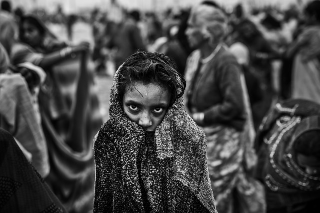 Ziv Koren, 'Allahabad, India Feb. 2013 - Hindu girl drying off after a holy dip at Sangam, the confluence of the holy rivers Ganga, Yamuna and the mythical Saraswati, during the Kumbh Mela festival.', 2013, Ouro Studio