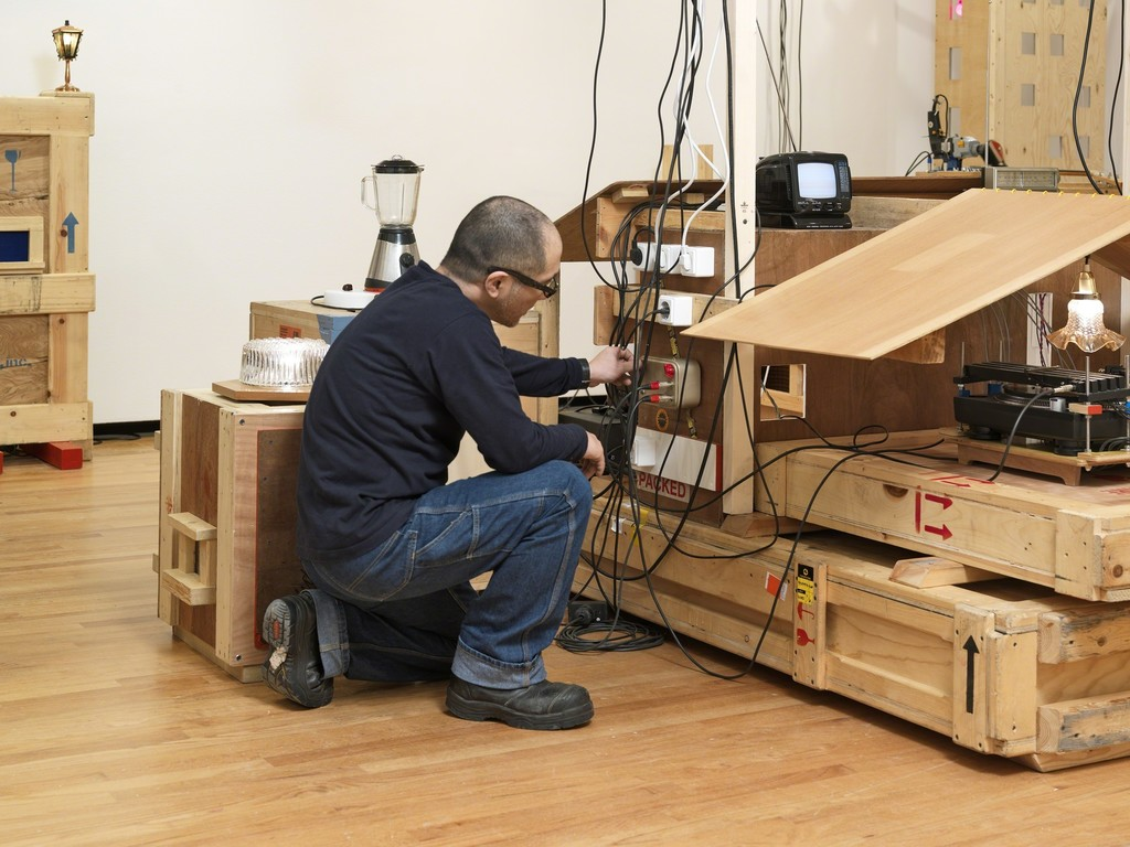 UJINO installing his work, Plywood City, 2008