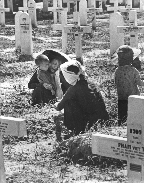 Robert Capa, 'Indochina, 1954. Mourners in a military cemetery for French and Vietnamese soldiers', 1954, Be-hold