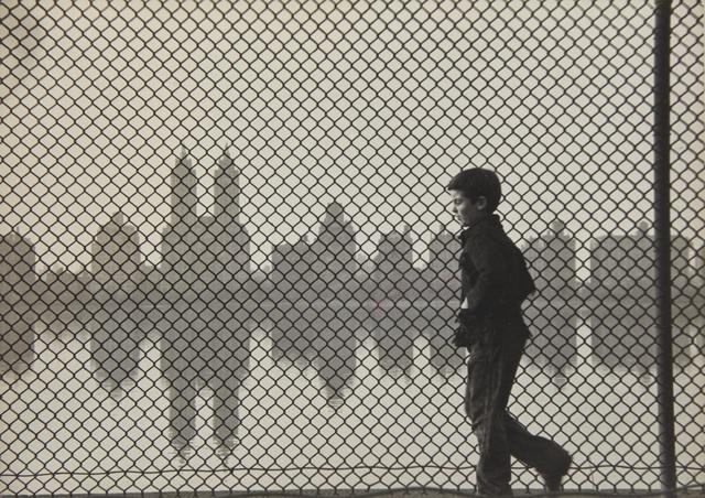 Ruth Orkin, ''Central Park Reservoir, Boy + Fence'', circa 1954, Sotheby's