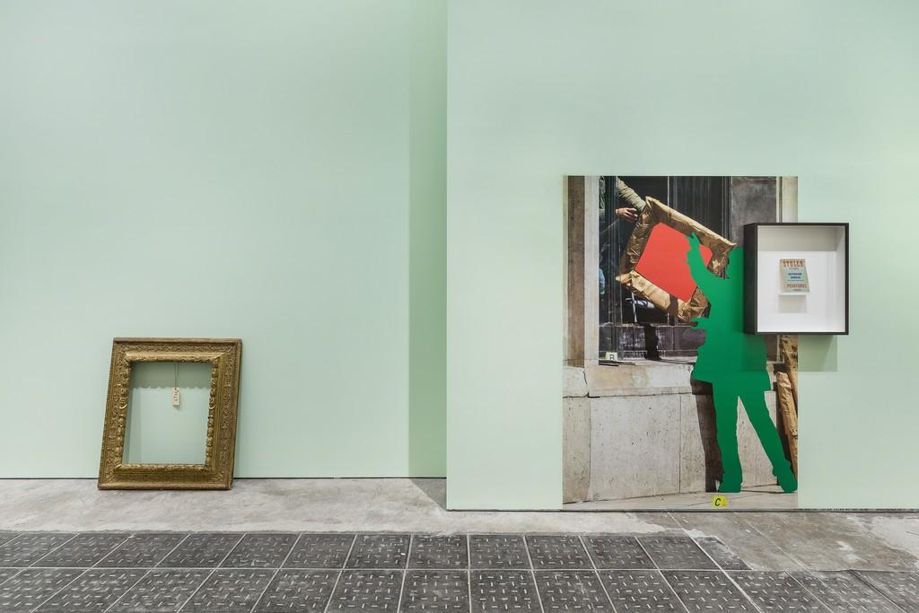 """Exhibition view at Fondazione Prada – Milano From left to right: Empty frame of Vincent van Gogh's Portrait of Dr. Gachet (1890) John Baldessari """"L'image volée"""" poster, 2015 – 2016 Stolen Pictures, 1948 Brochure Photo Delfino Sisto Legnani Studio Courtesy Fondazione Prada"""