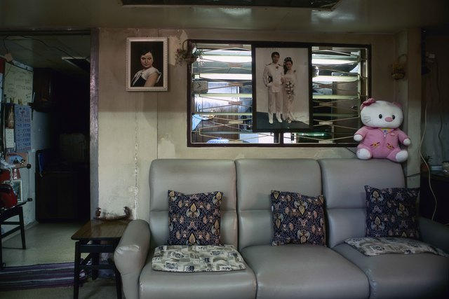 , '18_Still life with leatherette couch,  wedding portrait and a painting of the matriarch,' 2011, Art Vietnam Gallery