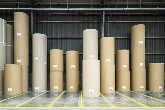 , 'Rolls of paper entirely produced from recovered cardboard and paper, ready to be transformed into corrugated cardboard or other packaging material. Paper  ber can be recycled this way up to seven times.,' 2015, Anastasia Photo