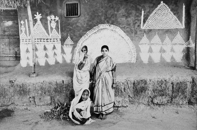, 'Three Oriya women in front of their house with a wall painted by them using rice flour,' 1987, Tasveer