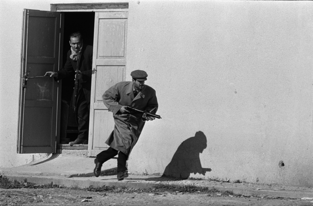 Don McCullin, 'Turkish defender leaving the side entrance of a cinema, Limassol, Cyprus', 1964, Howard Greenberg Gallery