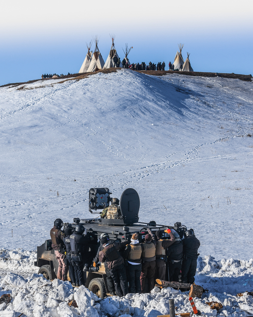 , 'Protesters face off with police and the National Guard on February 1, 2017, near Cannon Ball, North Dakota.,' , Monroe Gallery of Photography