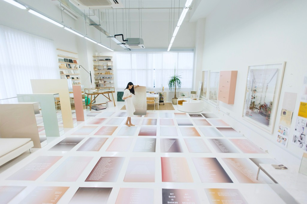 Dawn Ng, Studio Image 2017, Image Courtesy of the artist and Chan + Hori Contemporary, Singapore *Behind the scenes studio image - PERFECT STRANGER artwork test prints in shrunk dimensions to fit floor space