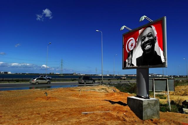 JR, 'INSIDE OUT - Tunisia, Ex Ben Ali Billboard on La Goulette Road', 2011, JR Studio