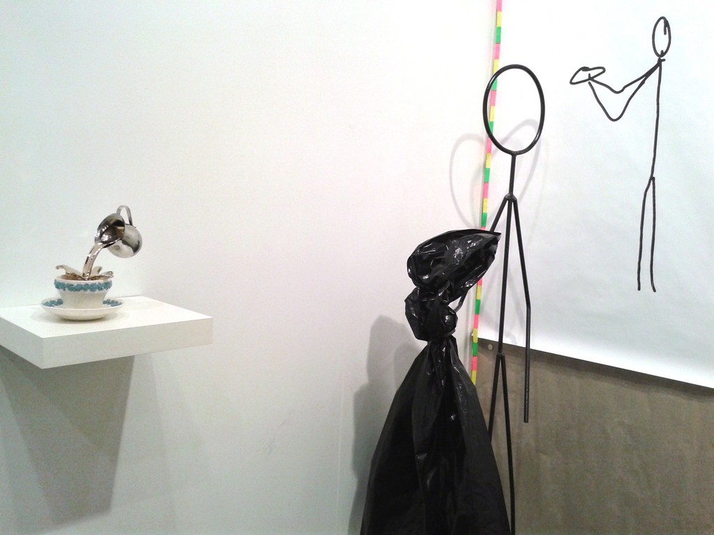 "Installation view - Oscar Figueroa, ""Cup Piece"" by Stevie Ellis at left"
