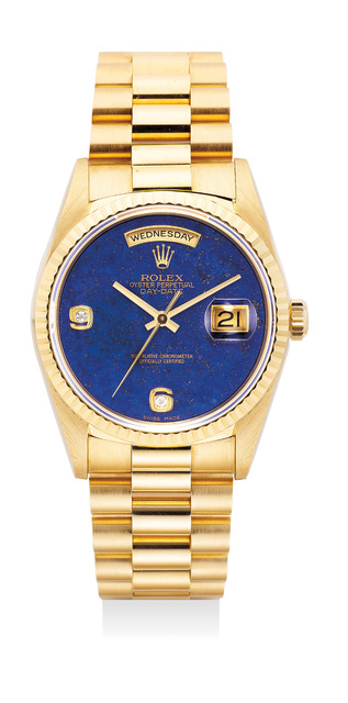 Rolex, 'A very attractive and unusual yellow gold wristwatch with sweep center seconds, day, date, lapis lazuli dial, diamond-set Arabic numerals, bracelet, guarantee and presentation box', 1990, Phillips