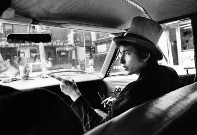, 'Bob Dylan with Top Hat Pointing In Car, Philadelphia, PA,' 1964, TASCHEN
