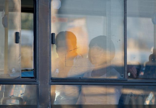 , 'Bus line 129 Couple,' 2013, AKINCI