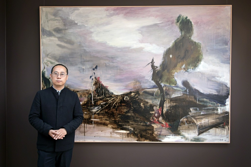 The artist in front of his landscape Windflüchter, a major new example of his landscape painting