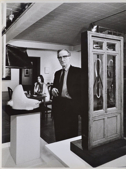 , 'Marcel Duchamp standing beside Fountain with Eve Babitz in background, Duchamp Retrospective, Pasadena Art Museum,,' 1963, Robert Berman Gallery
