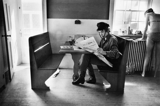 , 'Bob Dylan Reading the Herald Tribune, Woodstock, NY,' 1964, TASCHEN