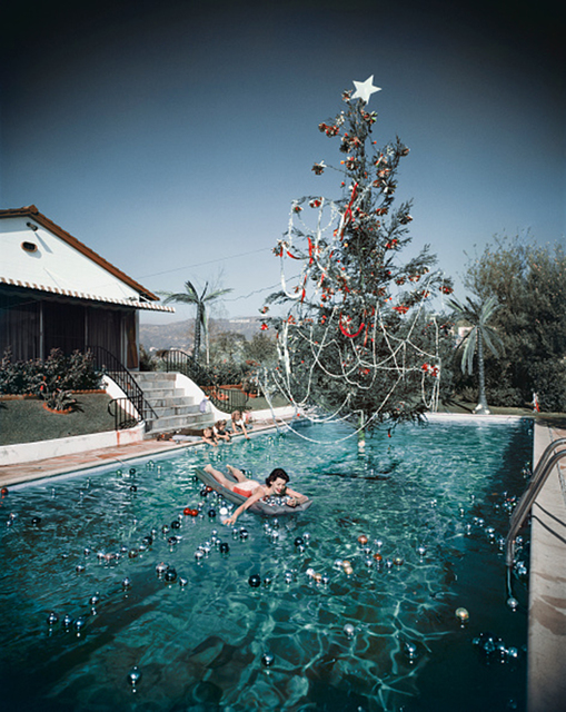 , 'Christmas Swim, 1954: Rita Aarons swimming in a pool festooned with floating baubles and a decorated Christmas tree, Hollywood, California,' 1954, Staley-Wise Gallery