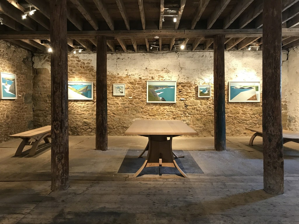 The ground floor gallery at Sladers Yard showing Vanessa Gardiner's new paintings with Petter Southall's Gallery Table and two different benches all in oak with steam bent curves.