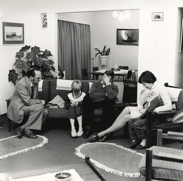 , 'Dominee S M van Vuuren of the Dutch Reformed Church, Whitfield, at prayer with a family during a pastoral call, Boksburg,' 17 June 1980, Pace/MacGill Gallery