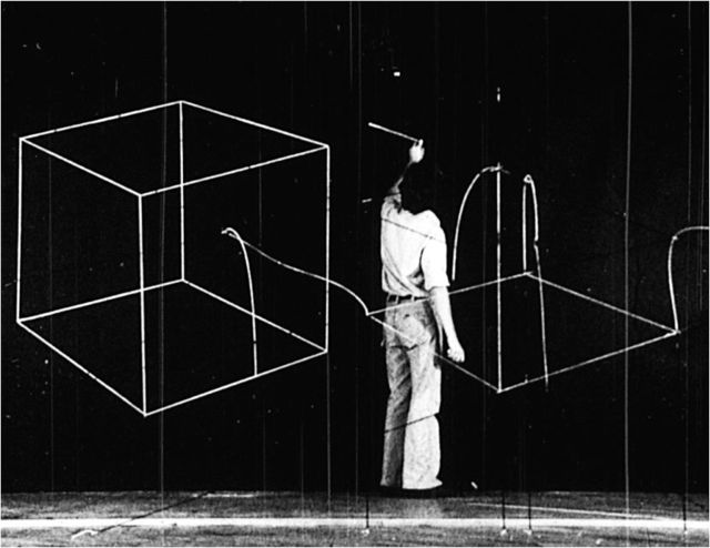 , 'Drawing in the Top of the Cut Cube on the Black Wall (Cubes, Frame No. 04:56:09),' 2012, Gavlak