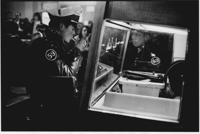 , 'Biker Lights a Cigarette at Juke Box, The 59 Club, Paddington, London,' 1964, Gallery Vassie