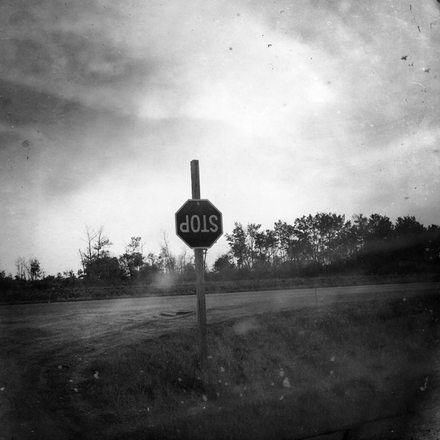, 'A stop sign hangs on the Muskowekwan Reserve in Saskwatchewan.,' 2015-2016, Anastasia Photo