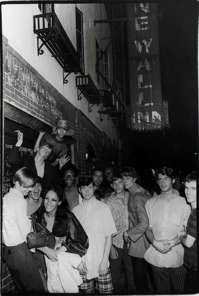 Fred McDarrah Celebration After Riots Outside Stonewall Inn, Nelly (Betsy Mae Koolo), Chris (Drag Queen Chris), Roger Davis, Michelle and Tommy Lanigan-Schmidt, June 1969 1969 Silver gelatin print 8 ½ x 11 in.  Collection Pavel Zoubok Image courtesy of Pavel Zoubok Gallery, New York Photo by Fred W. McDarrah/Getty Images