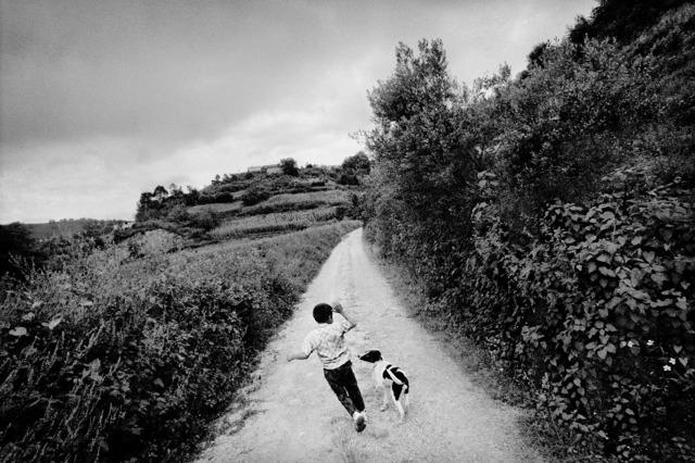 , 'A boy plays with his dog. San Miguel Cuevas, Mexico.,' 2006, Anastasia Photo