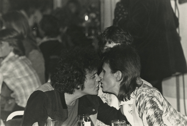 , 'Lou Reed and David Bowie, seated by Mick Jagger, kiss at the Café Royal, after Ziggy Stardust's last live performance at Hammersmith Odeon in London.,' 1973, Howard Greenberg Gallery
