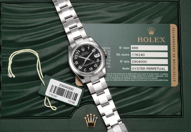 Rolex, 'A fine stainless steel wristwatch with black guilloché dial, date, bracelet, guarantee and presentation box', Circa 2008, Phillips