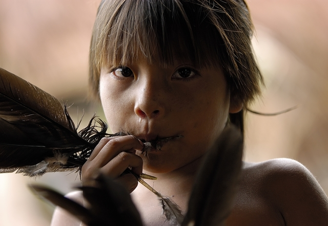 , 'Young Yanomami Child playing a Game with a Feather,' 2005, Gabarron Foundation