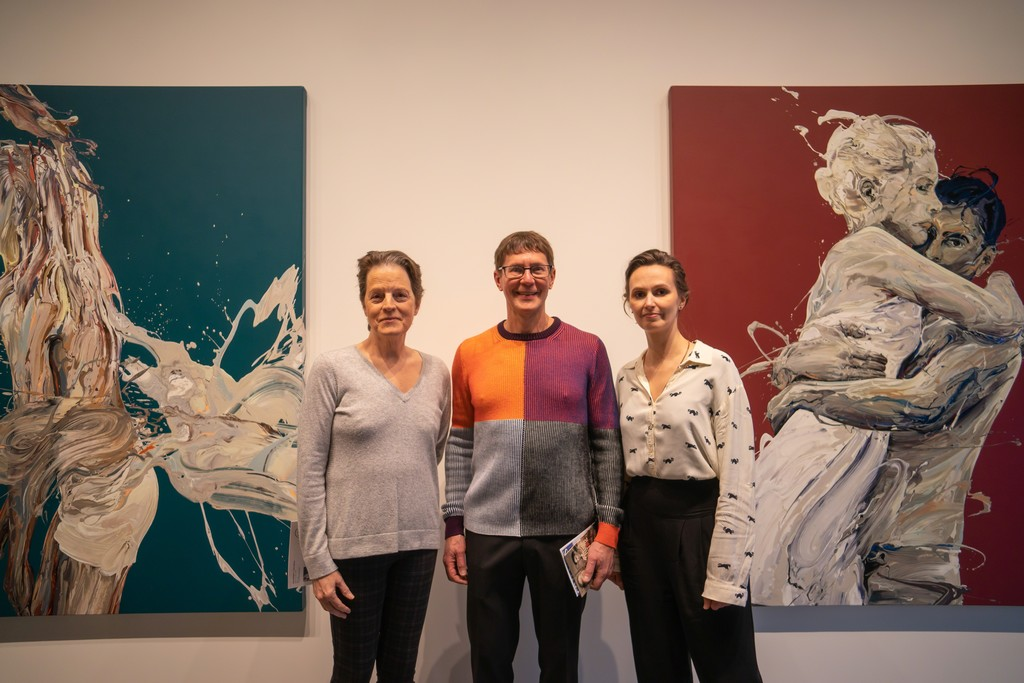 """Essay writer Barbara O'Brien (left), gallery owner Joseph Nease (center) and artist Sirpa Särkijärvi (right) at the opening reception.  """"Transcription 42 (Of the Stimuli) left, and """"Transcription 45"""" right."""