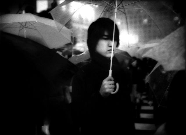 , 'Under umbrella in nighttime rain, Hachiko Shibuya, Tokyo, Japan,' 2002, Sous Les Etoiles Gallery