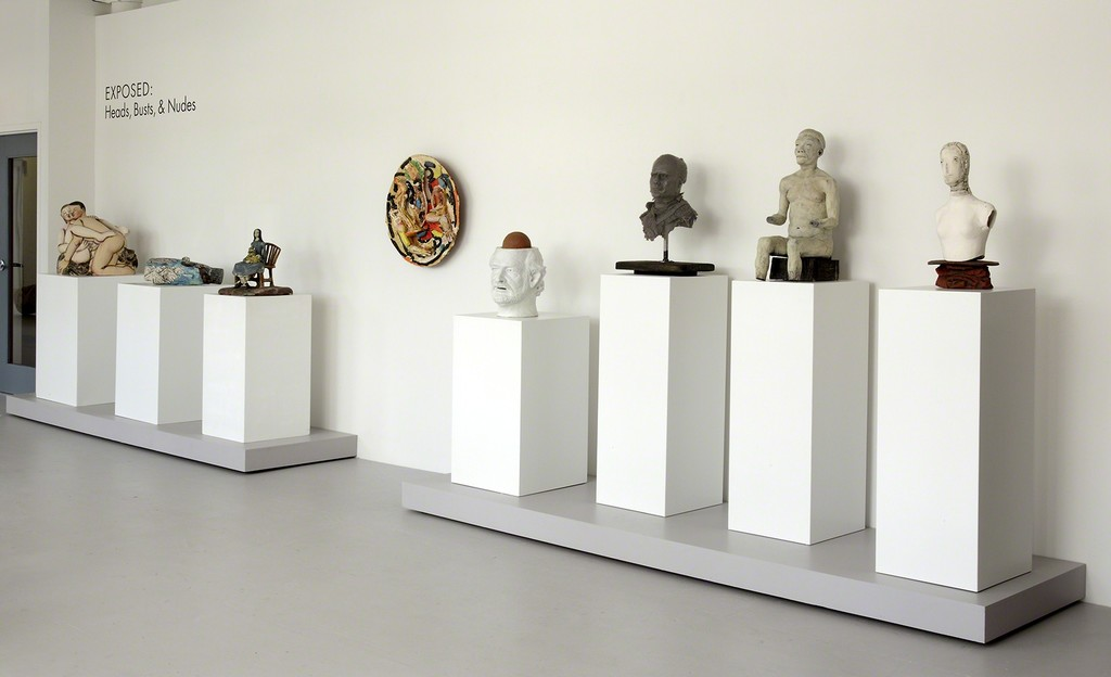 Row of heads, busts, and nudes in a classically-staged exhibit. (Photo by John Polak.)