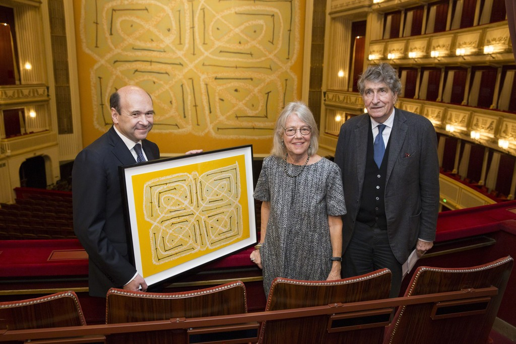 "Director Dominique Meyer, Kathrin Messner and Günter Rhomberg with a copy of the signed and numbered special edition of Joan Jonas in front of her ""Safety Curtain 2014/2015"", Vienna State Opera, 14-11-2014, Photo: Andreas Scheiblecker, © museum in progress (www.mip.at)"