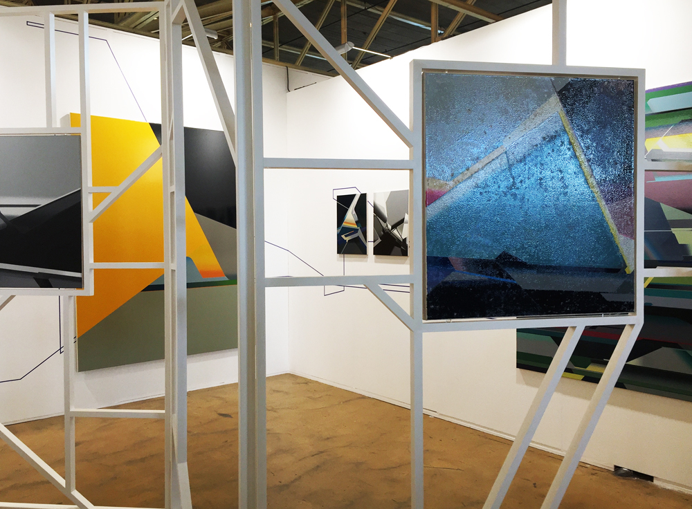 Carrying paintings into the space through the artist's 'Buttress' (system); photo: gallery