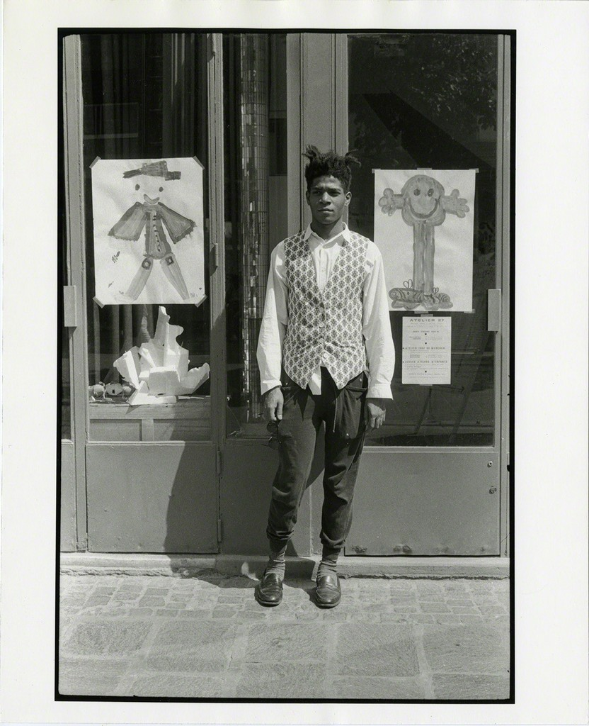 MICHAEL HALSBAND Jean-Michel Basquiat Standing outside Printmaking Studio Paris, France, July 1985
